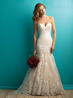 Allure 9257 Uniquely embroidered lace applique is the focal point of this fit and flare strapless gown.