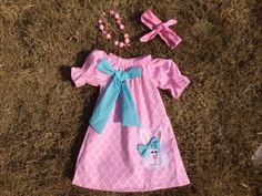 Set includes dress, headband and necklace.  This is a pre order item.