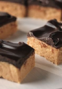 No-Oven Peanut Butter Squares – Skip the oven and go straight to dessert decadence with just 10 minutes of prep time! Each bar is a chunk of no-bake peanut-butter-and-chocolate paradise.