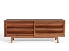 The Lewis Media Cabinet is the crystalizes everything we love about Mid Century Modern design in a hand crafted solid walnut piece that is sized to accommodate today's televisions. Sliding shutter doo