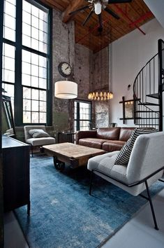 Apartment Living - love the blue of the carpet and the high ceilings - rustic industrial feel