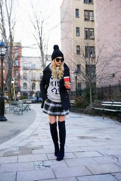 25 winter outfits to copy - graphic sweatshirt, black coat, plaid skirt, pom pom beanie + over the knee boots