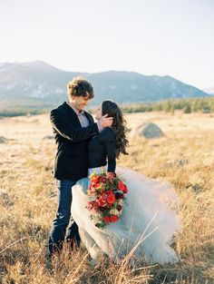 Rocky Mountain National park, Mountain Engagement Session, Grey Tulle Skirt, Red bouquet  Photo: Cassidy Brooke Photography www.cassidybrooke.com