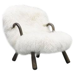 Iconic Clam Chair by Phillip Arctander Long White Hair Sheepskin and Wood, 1940 | From a unique collection of antique and modern armchairs at https://www.1stdibs.com/furniture/seating/armchairs/