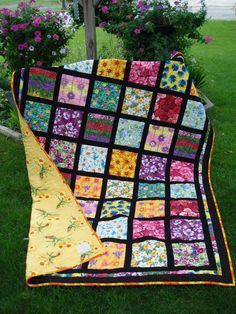 Really like the black contrast! on this charm square quilt...and I love the pattern on the back.