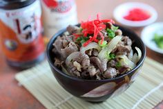 Gyudon  Serves 2 | Prep Time: 10 Minutes | Cook Time: 10 Minutes  Ingredients: Water, for boiling 1/2 lb thinly sliced beef for sukiyaki, cut into pieces 1/2 tablespoon oil 1/2 onion, sliced 1 teaspoon grated ginger 1 teaspoon chopped scallion Beni shoga  Sauce: 1 tablespoon Mizkan (Bonito Flavored) Soup Base 1 teaspoon soy sauce 1 1/2 tablespoons Mizkan Honteri Mirin 1 1/2 tablespoons sake 1 teaspoon sugar