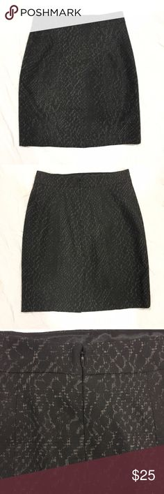 "Tahari patterned skirt Black and grey patterned midi skirt. Has a zipper down the back and a small slit on the bottom back. Length: 21"", waist: 15"" across. In great condition. Feel free to make me a reasonable offer 💕 Tahari Skirts Midi"