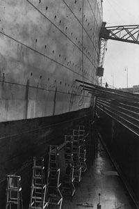 The massive side of the ocean liner's hull was held together by riveted plates. Dr. Robert Ballard, who found the wreck of the Titanic, suggested that the leak that sunk the ship happened when an iceberg collision caused faulty rivets to pop out of place and allow the hull plates to separate.