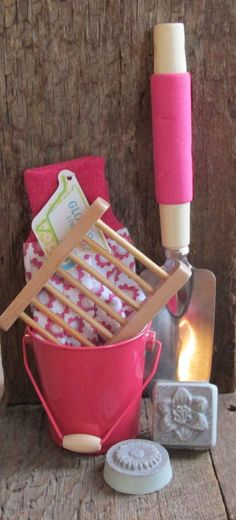 A great gift for your favorite gardener. Gift set includes two bars of special gardeners soap, wooden soap dish, garden gloves, trowel and a small bucket for carrying seeds or anything you need to bring to the garden. Choose either blue or pink. $12.50 HerbGardenBodyCare
