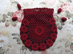 Red on black drawstring bag with roses motifs by Dawn Holbrook