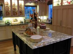 I took this picture at the Chicago Tom Bishop show of Ray Whitledge's (of Whitledge-Burgess Miniatures) Gorgeous kitchen! Photo by Nina Eary
