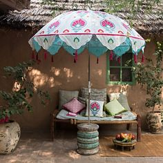 Our wonderful Dolly garden parasol is lovingly crafted using suzani block printing techniques in gorgeous pink & blue tones. This stunning garden umbrella with tassels is made in Jaipur by The East London Parasol Company. Moroccan Garden, Indian Garden, Outdoor Patio Umbrellas, Outdoor Decor, Women's Umbrellas, Outdoor Living, Garden Parasols, Lotus Design, Most Beautiful Gardens