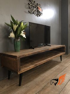 Made from reclaimed wood these bespoke TV stands can be made to different lengths and five different colours. The legs are made in a mid-century style. Reclaimed Wood Tv Stand, Tv Stand Decor, Diy Tv Stand, Wooden Tv Stands, Dark Wood Tv Stand, Tv Cabinet Design, Wood Stain Colors, Living Room Tv, Mid Century Style