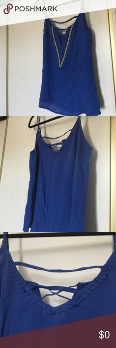 Cute Blue V Top *Reposh* bought this awhile ago and wore it a couple times. I hate to part with this but I have too many tops like this. Perfect for summer! Tops