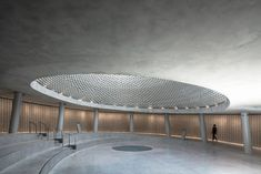 Image 26 of 42 from gallery of The Memorial Hall of Israel's Fallen at Mount Herzl / Kimmel Eshkolot Architects. Photograph by Amit Geron Military Cemetery, Concrete Bricks, Circle Light, National Cemetery, Construction, Roof Plan, Space Architecture, Interior Lighting, Skyscraper