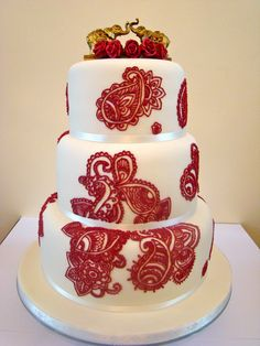 Henna design cake (As a DELTA I love this cake purely for the elephants on top!....R)
