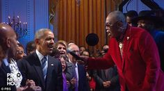 Soon after R&B singer, Sam Moore (right), took the lead and he and Obama sang together...