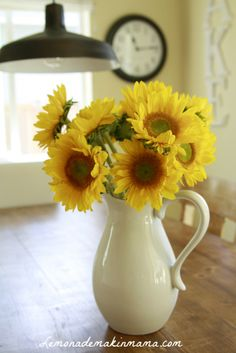 i love sunflowers in a white pitcher for a table centerpiece for Fall:)