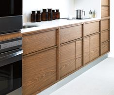 Treefrog Veneers Real Wood Laminate Installations.  Inset fronts with integral hardwood pulls on drawers and doors.