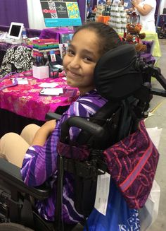 That smile leads us to believe she's a big fan of her new Demi-Premier Jewel Swirl bag! (2015 Boston Abilities Expo)