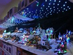 Christmas village with starry night sky.