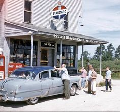 Family pit stop. Dowd's General Store and Standard Oil filing Station. Fiber, MI '50's