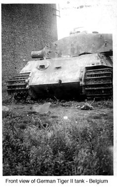 A knocked out King Tiger left abandoned after losing it's gun barrel during battle.