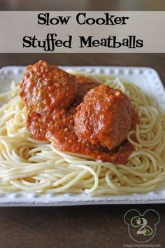 Spaghetti and meatballs make the perfect pair, just like you and your Valentine. Try this recipe for Slow Cooker Stuffed Meatballs and enjoy a dinner for two. Crock Pot Slow Cooker, Slow Cooker Recipes, Crockpot Recipes, Cooking Recipes, My Favorite Food, Favorite Recipes, Stuffed Meatballs, I Love Food, Yummy Food