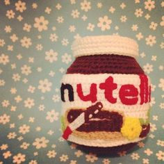 Take that out of your mouth. Although your immediate reaction was understandable, you will not be able to taste Nutella here.    Unless they make Nutella-flavored yarn. Is there such a thing? Perhaps one could infuse yarn with Nutella flavoring. It would undoubtedly be a popular product.    Link -via Craft