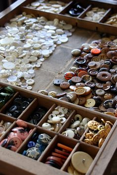 buttons is displayed in a vintage printer's drawer.