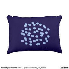 Accent pillow with blue polka dots