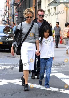 April 13 2014, New York City  Actress Meg Ryan walks with her daughter Daisy and her boyfriend John Mellencamp in Soho on April 13 2014 in New York City