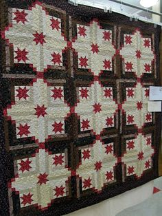 Love this quilt which mixes stars and log cabin blocks.