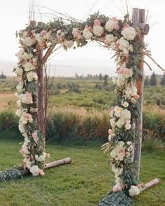 A floral arch anchored outdoor wedding ceremony