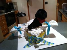 This is a kayak diaper cake with a black lab dog in it