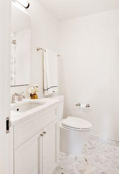White Bathroom with Marble Herringbone Floor Tiles White Bathroom, Small Bathroom, Bathrooms, Bathroom Ideas, Bath Design, Tile Design, Moving Walls, Southern Living Homes, Bathroom Floor Tiles