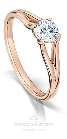 Elsa. Capturing the cool icy whiteness of a perfectly cut round brilliant diamond – set into your choice of precious metal. Choose from 950 Platinum, 18ct Gold, Fairtrade Gold or 950 Palladium. Image shows 18ct Rose Gold. This exceptional design has split shoulders and a graceful comfort fit band.