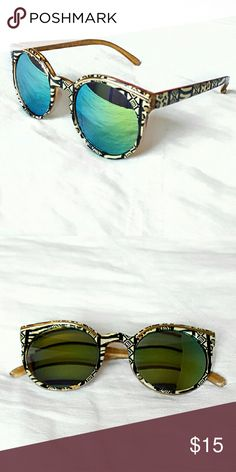 Sunglasses Geometric design (black and tan) with reflective lenses (blue-ish green). Cute and fun in photos! Accessories Sunglasses