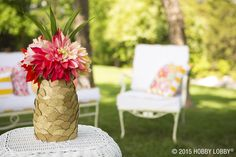 For an arrangement to impress and to invite, create a no-sticky hands solution to a Pineapple Floral Arrangement. To make this beautiful centerpiece, simply use a paper punch to cut glitter paper into circles, hot glue them onto a vase starting with the top, overlapping them to create a pineapple texture. Add your floral arrangement, and say hello to summer!