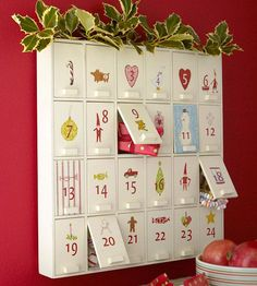 Behind Closed Doors.  Turn a wooden cabinet into a surprise-filled Advent calendar by embellishing each door with rub-on numbers and designs from the scrapbooking aisles.