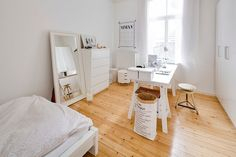 Exquisite home office in white with warm wooden flooring [From: Sven Fennema]