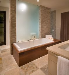 AMAZING TUB! The warm wood surround is perfectly balanced with the cool frosted glass and stone elements.