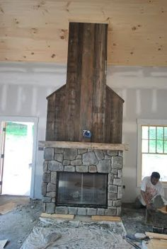 salvaged wood fireplace - don't like the rock but the salvaged wood is cool.
