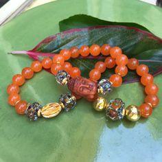 Orange Jade Gemstone With Ojime Buddha by JewelrybyKellyWalker