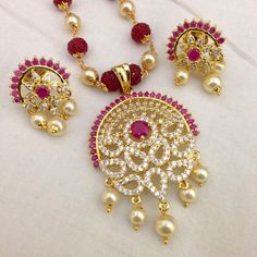 CZ and Ruby pendant with pearl drops and earrings Code : PS 397 Price: Rps. 1495/- Whatsap to 09581193795 for order processing