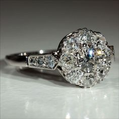 This gorgeous Art Deco diamond platinum and 18k gold engagement ring was made in England during the 1930's. 1.1ctw