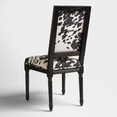Crafted of birch wood with a matte black finish, our dining side chairs are versatile classics with a square-back silhouette and smooth microfiber upholstery in a black and white cow print.
