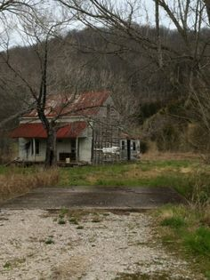 abandoned log farm house, it has been clapped over. you can see the log walls. this in maury county, tennessee.