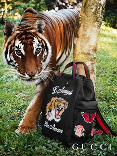 "Discover more gifts from the Gucci Garden. Embroidered with Gucci codes including the tiger, flowers and the phrase ""L'Aveugle Par Amour,"" the online-exclusive techpack."