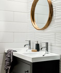Bathroom Tile Ideas - Install Tile To Add Texture To Your Bathroom // The ripples in these white bathroom tiles used on one wall add a wave-like look to the wall but are close enough to the style of the flat tiles to make the combination work. Cheap Bathroom Tiles, Modern Bathroom Tile, Bathroom Tile Designs, Bathroom Interior, Master Bathroom, Simple Bathroom, Bathroom Flooring, Modern Sink, Flooring Tiles